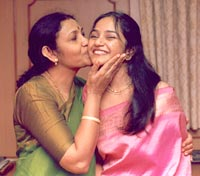 Madhi Malar with her mother