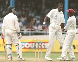Richardson (right) intervenes the confrontation between Waugh (left) and Ambrose
