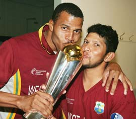 Mervyn Dillon and Shivnarine Chanderpaul with the 2004 Champions Trophy