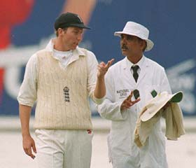 Umpire Ramaswamy with Michael Atherton