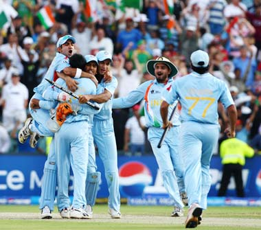 The Indian team celebrates the fall of the final wicket. It was India's first major triumph since winning the 60 overs-a-side World Cup in 1983