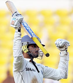 Harbhajan Singh celebrates completing his half-century in the fourth and final Test against Australia in Nagpur