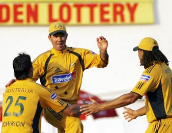 Australia captain Ricky Ponting (centre) celebrates with his team-mates
