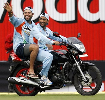 Dhoni taking Yuvraj for a ride on a bike