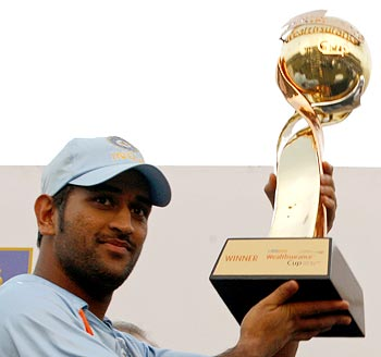 Dhoni poses with the trophy after India beat Sri Lanka 4-1 in the five-match ODI series