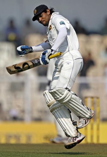 Tillakaratne Dilshan celebrates on getting a hundred