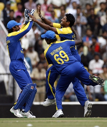 Sri Lanka players celebrate the dismissal of Sehwag