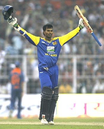 Upul Tharanga celebrates after century