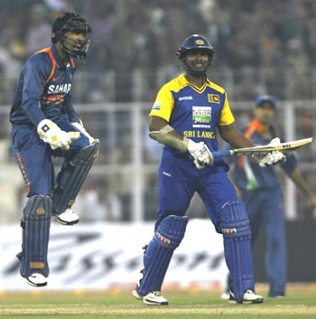 Dinesh Karthik celebrates after stumping Sangakkara