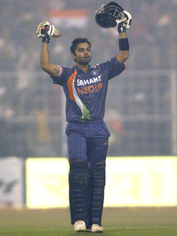 Virat Kohli celebrates after reaching century