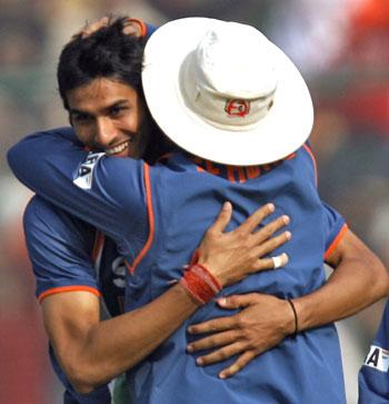 Sudeep Tyagi celebrates after dismissing Kumar Sangakkara