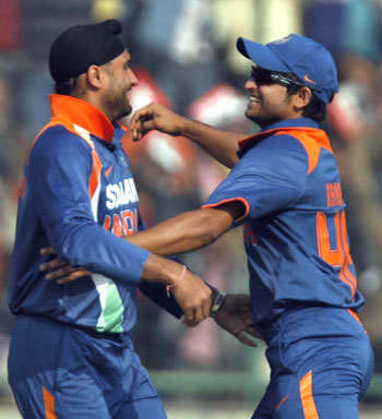 Harbhajan Singh is congratulated by Suresh Raina