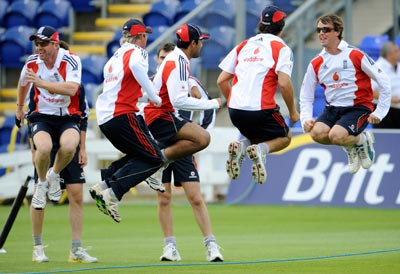 England's Paul Collingwood (left) and Graeme Swann (right) join teammates as they take part in skipping during a training session