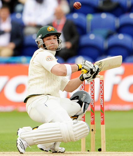 Australia opener Phillip Hughes lets an Andrew Flintoff bouncer go past him