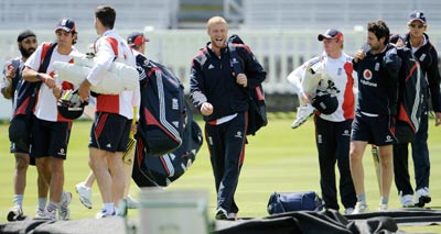 England's Andrew Flintoff (centre) and teammates head to the net area during a training session prior to the second Ashes Test against Australia at Lord's