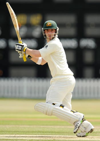 Australia's Phillip Hughes hits a four during their match at the County Ground in Hove, East Sussex