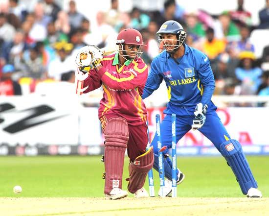 Shivnarine Chanderpaul is bowled by Mendis