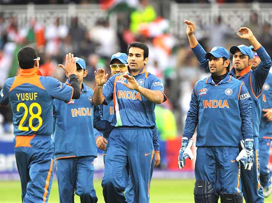 Zaheer Khan is congratulated by his teammates