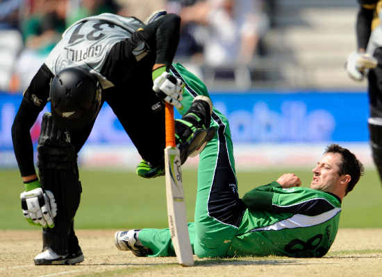 Martin Guptill makes his ground as Ireland's Alex Cusack makes a vain attempt to run him out