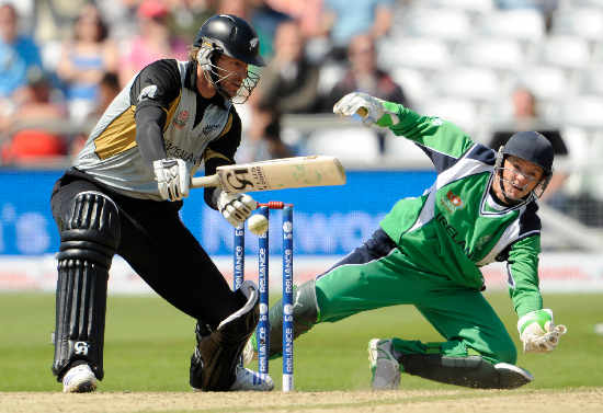 Ireland's Niall O'Brien makes a vain attempt to take an edge off Jacob Oram's bat.