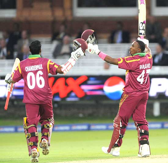Shivnarine Chanderpaul and Dwayne Bravo celebrate after winning the match