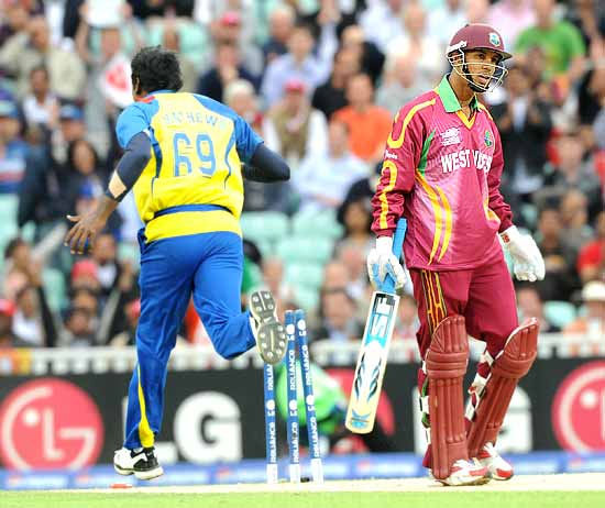 Angelo Mathews celebrates after bowling Lendl Simmons for a duck