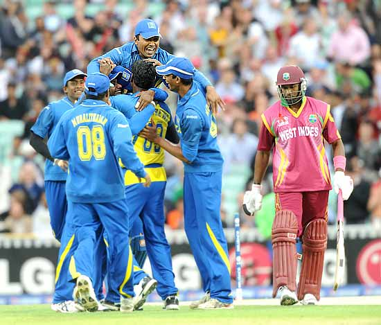 Angelo Mathews is swamped by his teammates after bowling Dwayne Bravo for a duck