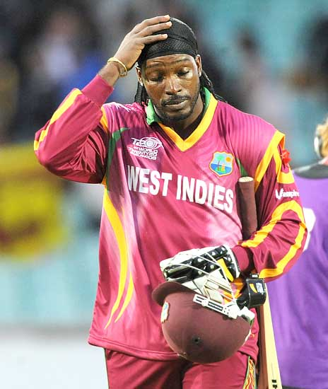 Chris Gayle walks back dejectedly after the end of the game