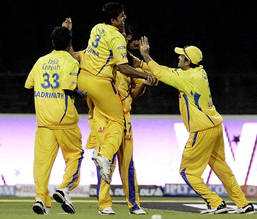 Chennai players celebrate a wicket
