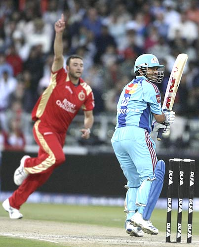 Bowler Dillon du Preez (left) celebrates the dismissal of Sachin Tendulkar