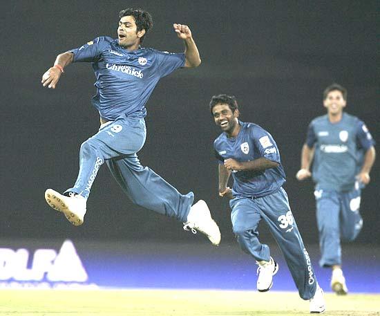 Rudra Pratap Singh celebrates after the dismissal of opener and Mumbai Indians captain Sachin Tendulkar
