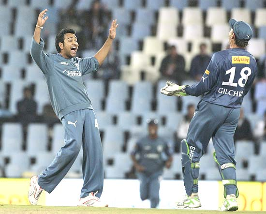 Rohit Sharma celebrates with Gilchrist after the dismissal of J P Duminy