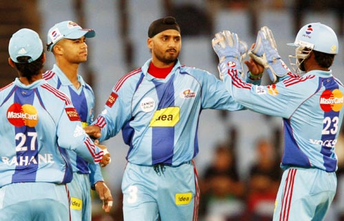 Harbhajan Singh celebrates with team-mates