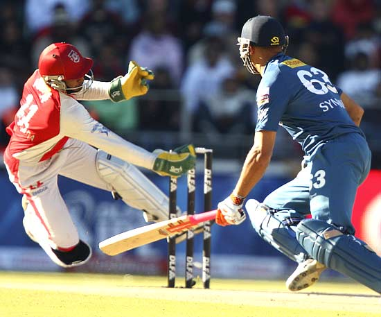 Wicketkeeper Kumar Sangakkara whips off the bails in a flash to stump Andrew Symonds for 25