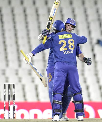 Yusuf Pathan and Graeme Smith celebrate their victory