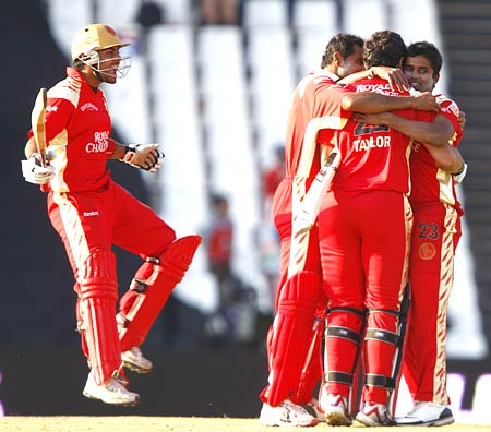 Royal Challengers Bangalore celebrate after beating Kings XI Punjab