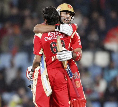Manish Pandey is congratulated by team-mate Virat Kohli