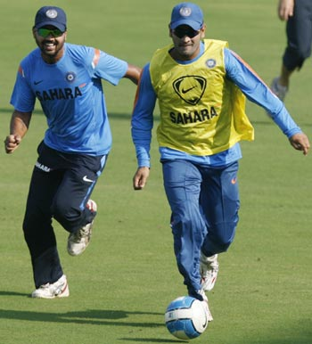 Indian captain MS Dhoni plays soccer with teammate Murali Vijay in Ahmedabad