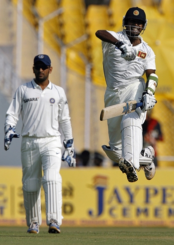 Prasanna Jayawardene celebrates after scoring a hundred