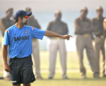 Gautam Gambhir goes through the paces during training amid tight security on Monday