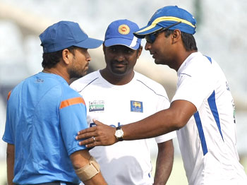 Sachin Tendulkar chats with Sri Lankan captain Kumar Sangakkara and Muttiah Muralitharan on Monday