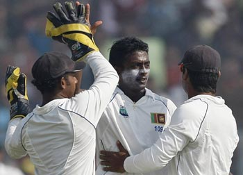 Ajantha Mendis being congratulated by his teammates