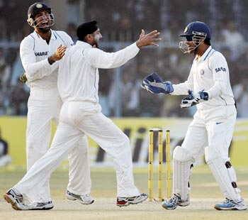 India's Harbhajan Singh celebrates taking the wicket of Sri Lanka's captain Sangakkara in Kanpur