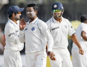 India's players celebrate after they won their second test cricket match against Sri Lanka in Kanpur