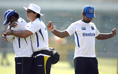Sangakkara (right) stretches as physio Tommy Simsek assists Jayawardene during a training session on Monday