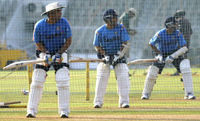 Virender Sehwag, Sachin Tendulkar and Rahul Dravid bat in the nets on Monday