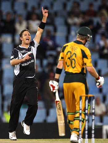 Shane Bond celebrates after taking the wicket of Tim Paine