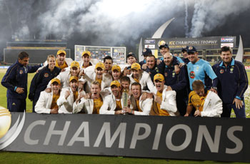 Members of the Australian cricket team celebrates victory in the ICC Champions Trophy after defeating New Zealand