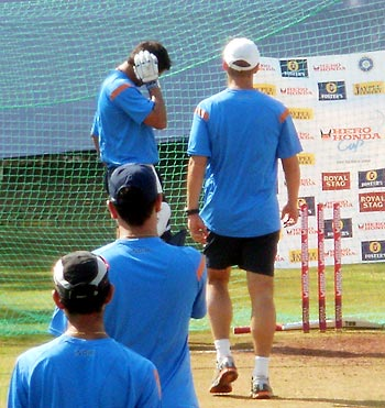 Coach Gary Kirsten walks towards Gambhir to take stock of the situation