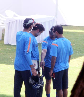Team physio Nitin Patel checks Gambhir